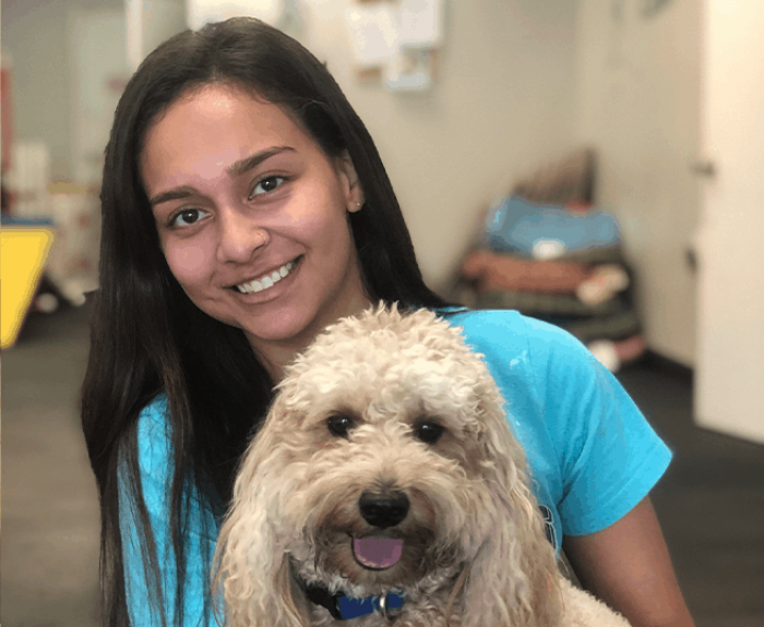 Breanna, one of our employees, bonding with one of our clients dogs that was boarded.
